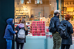© Licensed to London News Pictures. 02/11/2020. London, UK. Shoppers look in the window of a shop selling Christmas gifts in Richmond Town, South West London two days before another National lockdown. Prime Minister Boris Johnson announced on Saturday new Covid lockdown restrictions for England from Thursday with pubs, restaurants, non-essential shops and gyms to close. Later the Prime Minister will give a statement to the commons as he warns MPs that deaths from Covid-19's second wave could be twice as high as the first ahead of MPs voting on the Government's 4 week lockdown measures. Photo credit: Alex Lentati/LNP