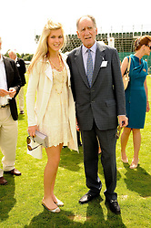 BARON THIERRY VAN ZUYLEN and his daughter ALLEGRA VAN ZUYLEN at the Cartier International Polo at Guards Polo Club, Windsor Great Park, Berkshire on 25th July 2010.