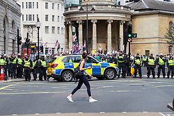 """A riot police cordon stretches across Langham Place as several hundred protesters in London in central London demand the release of """"political prisoner"""" right wing talisman Stephen Yaxley-Lennon  - also known as Tommy Robinson, who was imprisoned for contempt of court. London, August 03 2019."""