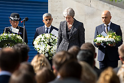 © Licensed to London News Pictures. 03/06/2018. London, UK. (L-R) Metropolitan Police Commissioner Cressida Dick,  Mayor of London Sadiq Khan, British Prime Minister Theresa May and Home Secretary Sajid Javid lay flowers to mark one year since the London Bridge and Borough Market terror attacks. A series of events have taken place throughout the day, including a service of commemoration at Southwark Cathedral, the planting of an olive tree in the Cathedral grounds, a minute's silence at 4:30pm and the laying of flowers.  Photo credit : Tom Nicholson/LNP