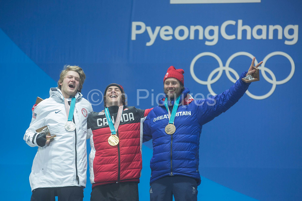 Billy Morgan, Great Britain, BRONZE with Sebastien Toutant, Canada, GOLD and Kyle Mack, USA, SILVER celebrate during the medal ceremony of the Snowboard Big Air on the 24th February 2018 at the Olympic Plaza, Pyeongchang-gun, South Korea