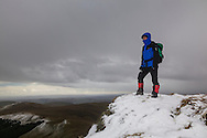 Standing above the rocky headwall of the corrie surrounding Llyn Lluncaws - with a far-reaching view below.