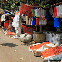 Asia, India, Calcutta. man carries load along street outside the flower market in Calcutta.