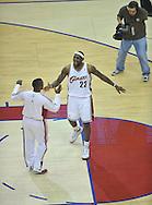 LeBron James goes through a pre game ritual with teammate Damon Jones.