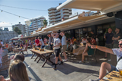 © Licensed to London News Pictures.  29/06/2021. Magaluf, Spain. British football supporters react to their game with Germany during the EURO 2020 match watch on a big screen in Magaluf, Balearic Islands. Photo credit: Marcin Nowak/LNP