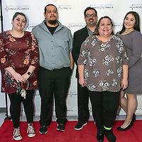 Teacher of the Year Justine Triplehorn front, stands with her family at the Grants Cibola County Chamber of Commerce Banquet on Saturday at the Knights of Columbus Hall