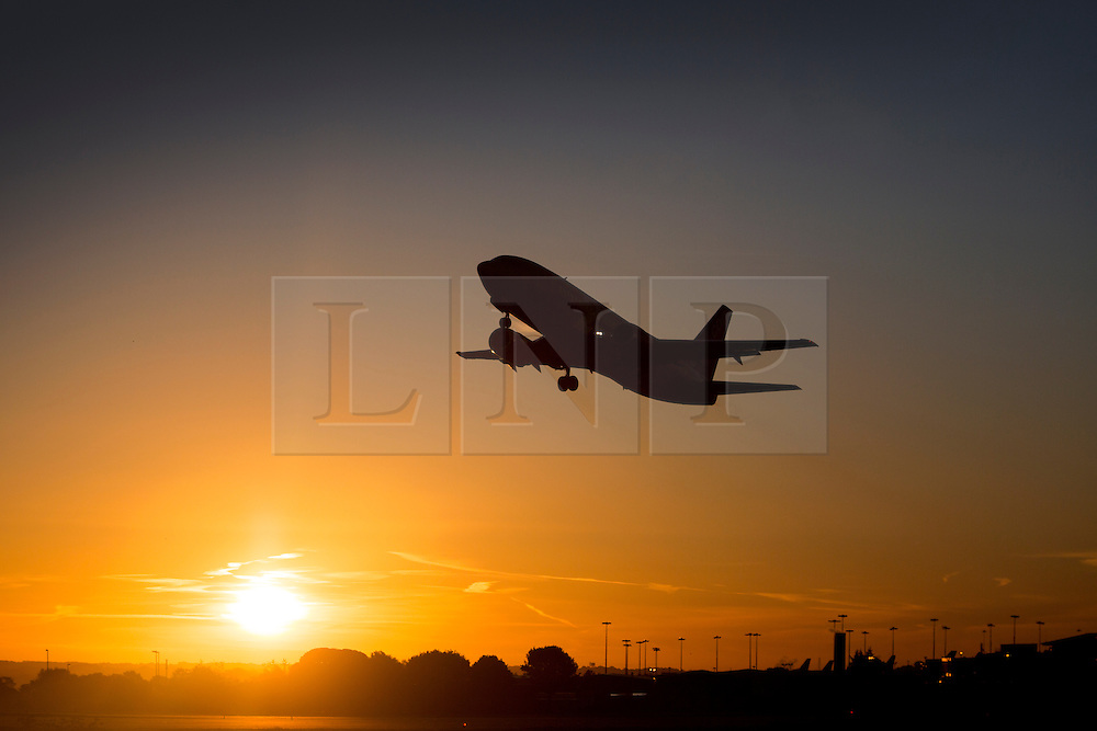 © Licensed to London News Pictures. 08/10/2015. Leeds, UK. Picture shows holiday makers escaping the British weather at Leeds Bradford airport. Photo credit: Andrew McCaren/LNP