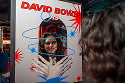 © Licensed to London News Pictures. 25/10/2021. LONDON, UK. Bowie fan, Farida Doss, at the opening of a David Bowie pop-up shop in Heddon Street in the West End.  Open 75 days before the late singer's 75th birthday, the pop-up is located close to where Bowie posed as Ziggy Stardust on the cover of his 1972 album The Rise and Fall of Ziggy Stardust and the Spider from Mars.  The store sells limited edition records and memorabilia curated by his estate and will be open until January 2022. A sister shop will open in New York and both form part of a year long celebration of David Bowie's 75th birthday.  Photo credit: Stephen Chung/LNP