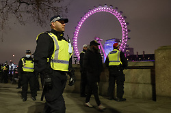 © Licensed to London News Pictures. 31/12/2020. London, UK. Police move people on and make arrests on New Year's Eve near Parliament in central London. Photo credit: Peter Macdiarmid/LNP