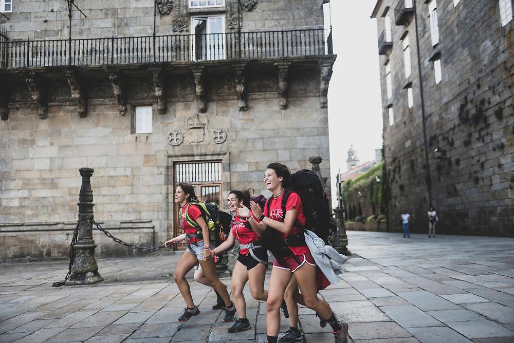A group of teenagers run as they enter Obradoiro Square, the end-point of their walk on the Camino de Santiago in Santiago de Compostela, Spain. (July 14, 2018)<br /> <br /> DAY 48: STAYED IN SANTIAGO DE COMPOSTELA