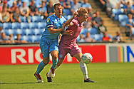 Michael Doyle fouls Andy Cannon during the EFL Sky Bet League 1 match between Coventry City and Rochdale at the Ricoh Arena, Coventry, England on 1 September 2018.
