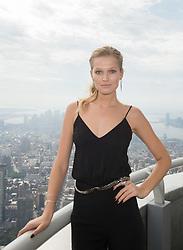 Oct. 9, 2015 - New York, NY, USA - Supermodel and Plan International Ambassador TONI GARRN lights the Empire State Building for Plan International USA in honor of ''International Day of the Girl'', Friday, Oct. 9, 2015. (Credit Image: © Bryan Smith/ZUMA Wire)
