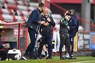 Cheltenham Town assistant manager Russell Milton talking to Stevenage Manager Alex Revell  during the EFL Sky Bet League 2 match between Stevenage and Cheltenham Town at the Lamex Stadium, Stevenage, England on 20 April 2021.