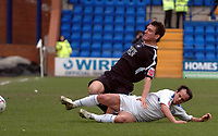 Photo: Paul Greenwood.<br />Tranmere Rovers v Swansea City. Coca Cola League 1. 10/03/2007.<br />Swansea's Paul Abbott (L) looses out to the challenge of Chris Shuker