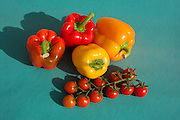 Cherry Tomatoes and Bell Peppers on green background