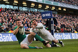 Ireland's Robbie Henshaw touches down for his sides first try- Photo mandatory by-line: Ken Sutton/JMP - Mobile: 07966 386802 - 01/03/2015 - SPORT - Rugby - Dublin - Aviva Stadium - Ireland v England - Six Nations