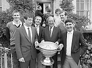 Sam Maguire Cup At Abbeyville..1986..22.09.1986..09.22.1986..22nd September 1986..Members of The Kerry,All Ireland winning team payed a courtesy call to Abbeyville, the home of Mr Charles Haughey T.D. They carried with them The Sam Maguire Cup, won at Croke Park the previous day...Image of (L-R)  Tom Spillane,Tommy Doyle,Team Captain,Paudie O'Se, Charles Haughey TD ,Jack O'Shea and team manager Mick O'Dwyer with the Sam Maguire Cup on the steps of the Haughey residence,Abbeyville.