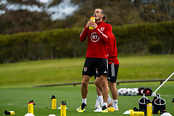 CARDIFF, WALES - Saturday, September 5, 2020: Wales' captain Gareth Bale drinks from a plastic SIS bottle during a training session at the Vale Resort ahead of the UEFA Nations League Group Stage League B Group 4 match between Wales and Bulgaria. (Pic by David Rawcliffe/Propaganda)
