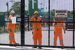 Harefield, UK. 22 July, 2020. HS2 workers monitor a gate to a drilling site for works in conjunction with the HS2 high-speed rail link. HS2 is currently projected to cost £106bn and will remain a net contributor to CO2 emissions during its projected 120-year lifespan.