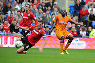 Cardiff city's Mark Hudson (l) watches as a shot from Wolverhampton's Sylvan Ebanks-Blake (r) goes inches wide of goal. NPower championship, Cardiff city v Wolverhampton Wanderers at the Cardiff city stadium in Cardiff, South Wales on Sunday 2nd Sept 2012. pic by  Andrew Orchard, Andrew Orchard sports photography,