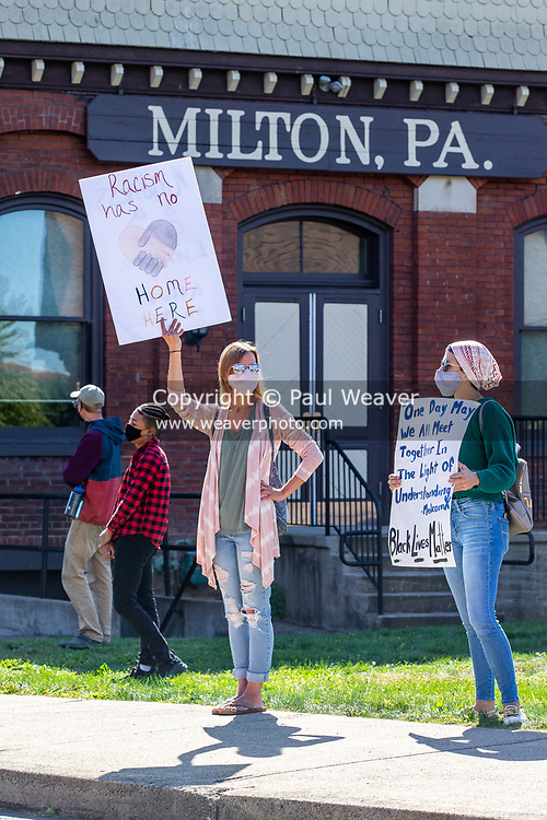 Protesters hold signs at a Black Lives Matter rally organized by the anti-racist collective 'If Not Us, Then Who?' in Milton, Pennsylvania.