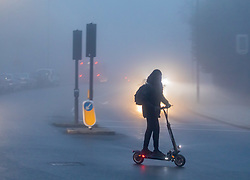© Licensed to London News Pictures. 08/12/2020. London, UK. A Commuter heads to work in the fog on a scooter in Putney, South West London as the Met Office issue another yellow weather warning for freezing fog with disruption to transport for the South East of England this morning. Today a 90 year old grandmother, Margaret Keenan became the first person in the World to get an approved Pfizer Covid-19 vaccine as the government and NHS has kicked off the biggest vaccination drive in UK history. Photo credit: Alex Lentati/LNP