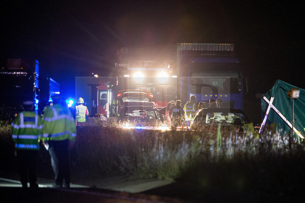 © Licensed to London News Pictures . 21/07/2014 . Ranby , UK . Emergency services at the scene where three people have died in a crash involving a number of vehicles on the A1 road at Ranby, near Worksop, Nottinghamshire this morning (21/07/2014). Photo credit : Joel Goodman/LNP
