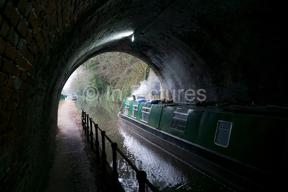 Canal narrowboat passes through a tunnel on the Worcester and Birmingham Canal in Birmingham, United Kingdom. The Worcester and Birmingham Canal is a canal linking Birmingham and Worcester in England. It starts in Worcester, as an offshoot of the River Severn and ends in central Birmingham. It is 29 miles long.