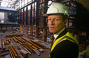 A portrait of Tate Modern art Gallery Director Sir Nick Serota during the refurbishment of the south bank power station's Turbine Hall in 1998. Wearing hard hat and high-vis clothing on this dangerous construction site, Serota looks over his left shoulder with the view that will in future exhibit some of the world's most engaging art works. Sir Nicholas Andrew Serota (born 27 April 1946 is a British art curator. He was director of the Whitechapel Gallery, London, and The Museum of Modern Art, Oxford, before becoming director of the Tate, the United Kingdom's national gallery of modern and British art in 1988. He was awarded a knighthood in 1999. He has been the chairman of the Turner Prize jury. He was the driving force behind the creation of Tate Modern, which opened in 2000.