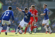 James McCarthy of Everton gets away from Lucas Leiva of Liverpool. Barclays Premier League match, Everton v Liverpool at Goodison Park in Liverpool on Sunday 4th October 2015.<br /> pic by Chris Stading, Andrew Orchard sports photography.