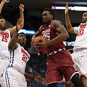 Quenton DeCosey, (centre), Temple, rebounds during the Temple Vs SMU Semi Final game at the American Athletic Conference Men's College Basketball Championships 2015 at the XL Center, Hartford, Connecticut, USA. 14th March 2015. Photo Tim Clayton