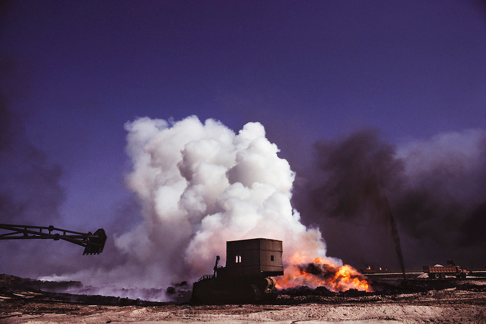 Firefighters preparing a burning oil well so that the damaged well head can be capped in the Magwa field near Ahmadi, Kuwait. More than 700 wells were set ablaze by retreating Iraqi troops creating the largest man-made environmental disaster in history.