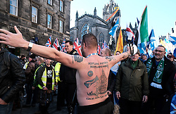 All Under One Banner Independence March, Edinburgh, Saturday 6th October 2018<br /> <br /> Pictured: A marcher shows his tattoos to the small British Nationalist group counter protesting<br /> <br /> Alex Todd | Edinburgh Elite media