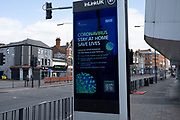 HM Government, and NHS advertising boards advice to stay at home and help save lives in Birmingham city centre is virtually deserted due to the Coronavirus outbreak on 31st March 2020 in Birmingham, England, United Kingdom. Following government advice most people are staying at home leaving the streets quiet, empty and eerie. Coronavirus or Covid-19 is a new respiratory illness that has not previously been seen in humans. While much or Europe has been placed into lockdown, the UK government has announced more stringent rules as part of their long term strategy, and in particular social distancing.