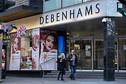 Shoppers walk past the closed Debenhams department store in London's Oxford Street as the second lockdown of the Coronavirus pandemic comes to a end, and a day before London enters the Tier 2 restriction when retailers will be allowed to once again re-open for the run-up to Christmas, on 1st December 2020, in London, England. 12,000 jobs are said to be at risk after financial negotiations failed the day after Topshop owner Arcadia fell into administration.
