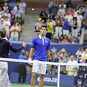 Eva Asderaki-Moore of Greece, the first female chair umpire for a U.S. Open men's singles final, tosses the coin before the start of the Roger Federer, Switzerland, against Novak Djokovic, Serbia match during the US Open Tennis Tournament, Flushing, New York, USA. 13th September 2015. Photo Tim Clayton