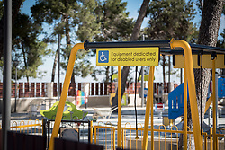 28 February 2020, Jerusalem: 'Equipment dedicated for disabled users only' reads a sign by a playground on the Augusta Victoria Hospital campus on the Mount of Olives in Jerusalem.