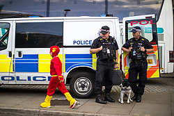 © Licensed to London News Pictures . 30/07/2017 . Manchester , UK . The Flash (Ben Campey, eight from Hull) walks by police who are watching over crowds at the venue . Cosplayers, families and guests at Comic Con at the Manchester Central Convention Centre . Photo credit : Joel Goodman/LNP