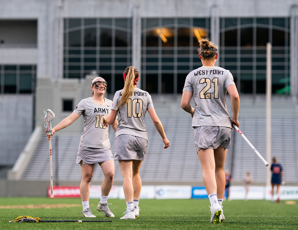 Megan Raftery of the Army Black Knights, Samantha Stewart of the Army Black Knights, Caroline Raymond of the Army Black Knights during an NCAA Division I women's lacrosse game between the Army Black Knights and Bucknell Bison at Michie Stadium on April 25, 2019 in West Point, NY.