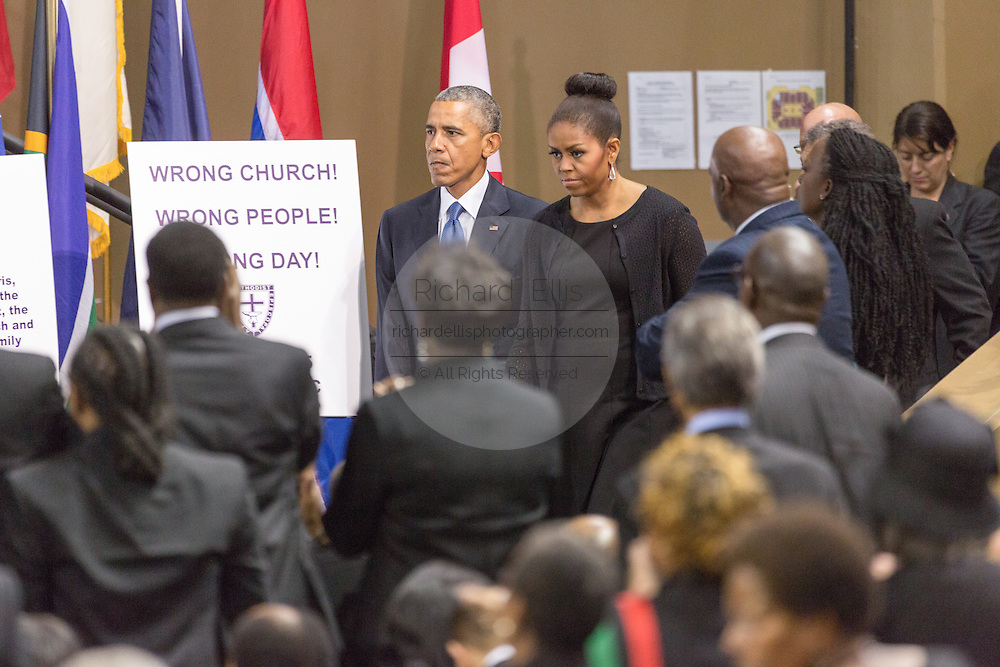 U.S. President Barack Obama and First Lady Michelle Obama arrive for the funeral of slain State Senator Clementa Pinckney at the TD Arena June 24, 2015 in Charleston, South Carolina. Pinckney is one of the nine people killed in last weeks Charleston church massacre.