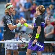 2019 US Open Tennis Tournament- Day Two.  Andrey Rublev of Russia is congratulated by Stefanos Tsitsipas of Greece after his victory in the Men's Singles Round One match on Louis Armstrong Stadium at the 2019 US Open Tennis Tournament at the USTA Billie Jean King National Tennis Center on August 27th, 2019 in Flushing, Queens, New York City.  (Photo by Tim Clayton/Corbis via Getty Images)