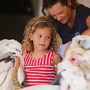 Tracy Skrabal fits plastic bags to Izzie Culperrer, 6, to simulate how a sea turtle may see them in the water Thursday August 7, 2014 during an N.C. Coastal Federation Night Turtle Walk in Wrightsville Beach, N.C. Last week's excavation of  the town's only nest saw 99 of 102 eggs be successful. (Jason A. Frizzelle)