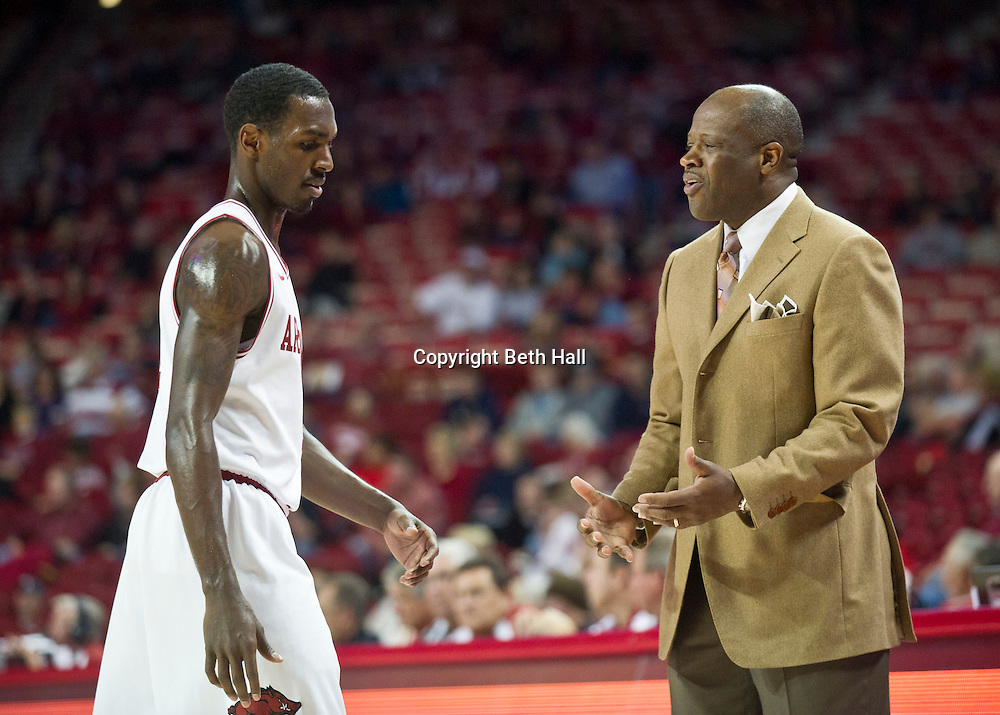 Nov 26, 2011; Fayetteville, AR, USA; Arkansas Razorback head coach Mike Anderson talks with guard Mardracus Wade (1) during a game against Grambling State Tigers at Bud Walton Arena. Arkansas defeated Grambling 86-44. Mandatory Credit: Beth Hall-US PRESSWIRE