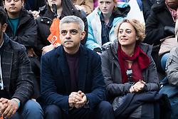 © Licensed to London News Pictures. 05/03/2017. LONDON, UK.  Sadiq Khan, Mayor of London with his wife, Saadiya Khan listens to speeches by feminist activists at the March4Women, organised by CARE International to mark International Women's Day. The Women's Day March begins at The Scoop near City Hall, before proceeding over Tower Bridge and finishing at the Tower of London. Photo credit: Vickie Flores/LNP