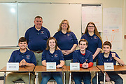 Ready for the fourth round, the Edmonson County, Ky., High School Quiz Bowl team members are, seated, from left, Brycen Daniels, 13, a seventh-grader, Evy Bolton, 13, a seventh-grader, Brody Johnson, 14, an eighth-grader and team captain and Jonas Miller, 14, an eightth-grader. Standing behind them are the coach Gregory Grey, Robin Grey and substitute player Emma Sackett, 12, a seventh-grader.<br /> <br /> Teams compete in the preliminary rounds of the 2019 Kentucky Quiz Bowl Alliance Middle School State championship Saturday, April 27, 2019, at Noe Middle School in Louisville, Ky. (Photo by Brian Bohannon)