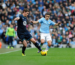 Manchester City's goal scorer, Jesus Navas closes down Tottenham Hotspur's Jan Vertonghen - Photo mandatory by-line: Dougie Allward/JMP - Tel: Mobile: 07966 386802 24/11/2013 - SPORT - Football - Manchester - Etihad Stadium - Manchester City v Tottenham Hotspur - Barclays Premier League
