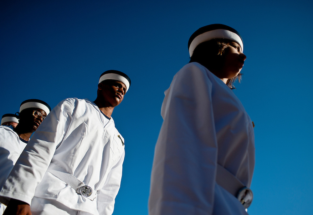 """New midshipmen parade in front of family and friends shortly before taking the Midshipman Oath of Office. Approximately 1,230 young men and women arrived at the U.S. Naval Academy's Alumni Hall, Thursday, July 1, for Induction Day to begin their new lives as """"plebes"""" or midshipmen fourth class (freshmen). """"I-Day"""" culminates when the members of the Class of 2014 take the oath of office at a ceremony at 6 p.m. in Tecumseh Court, the historic courtyard of the Bancroft Hall dormitory. Over 17,400 young men and women applied to be members of the Naval Academy Class of 2014 - a record for USNA."""