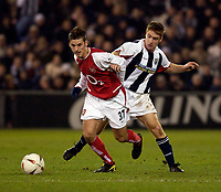 Photo. Jed Wee.<br /> West Bromwich Albion v Arsenal, Carling Cup, The Hawthorns, West Bromwich. 16/12/2003.<br /> Arsenal's David Bentley (L) and West Brom's James O'Connor challenge for possession.