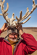 Colin Monteath wearing reinder antlers, Northern Mongolia, March 2014