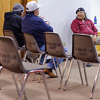 021314       Cable Hoover<br /> <br /> Kenneth Seowtewa chats with visitors before his presentation at the Octavia Fellin Public Library in Gallup Thursday.